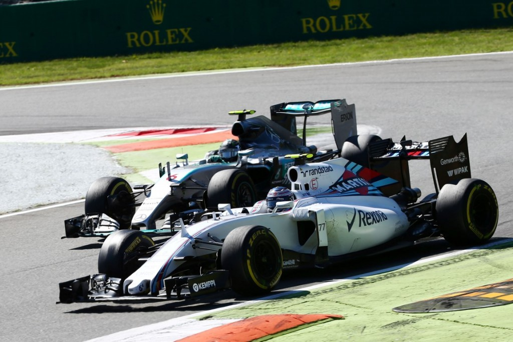Formula One World Championship 2015, Round 12, Italian Grand Prix, Monza, Italy, Sunday 6 September 2015 - Valtteri Bottas (FIN) Williams FW37 and Nico Rosberg (GER) Mercedes AMG F1 W06 battle for position.