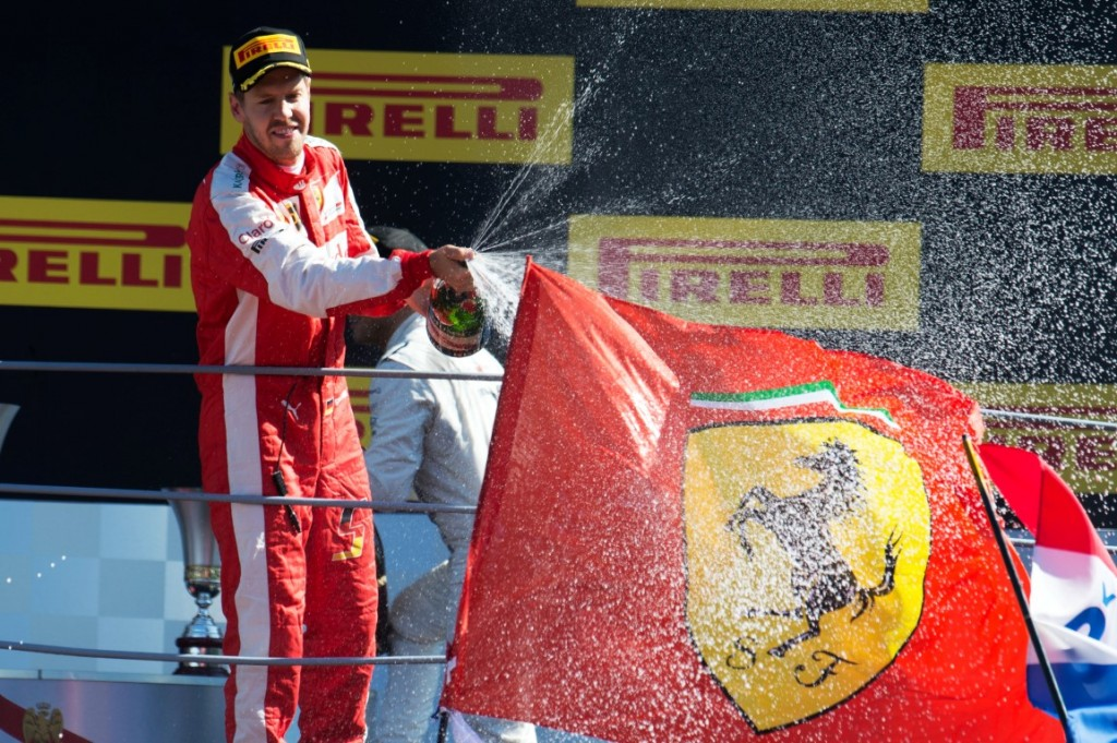 Formula One World Championship 2015, Round 12, Italian Grand Prix, Monza, Italy, Sunday 6 September 2015 - Sebastian Vettel (GER) Ferrari celebrates his second position on the podium.