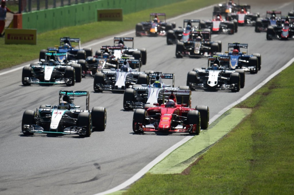 Formula One World Championship 2015, Round 12, Italian Grand Prix, Monza, Italy, Sunday 6 September 2015 - L to R): Lewis Hamilton (GBR) Mercedes AMG F1 W06 and Sebastian Vettel (GER) Ferrari SF15-T at the start of the race.